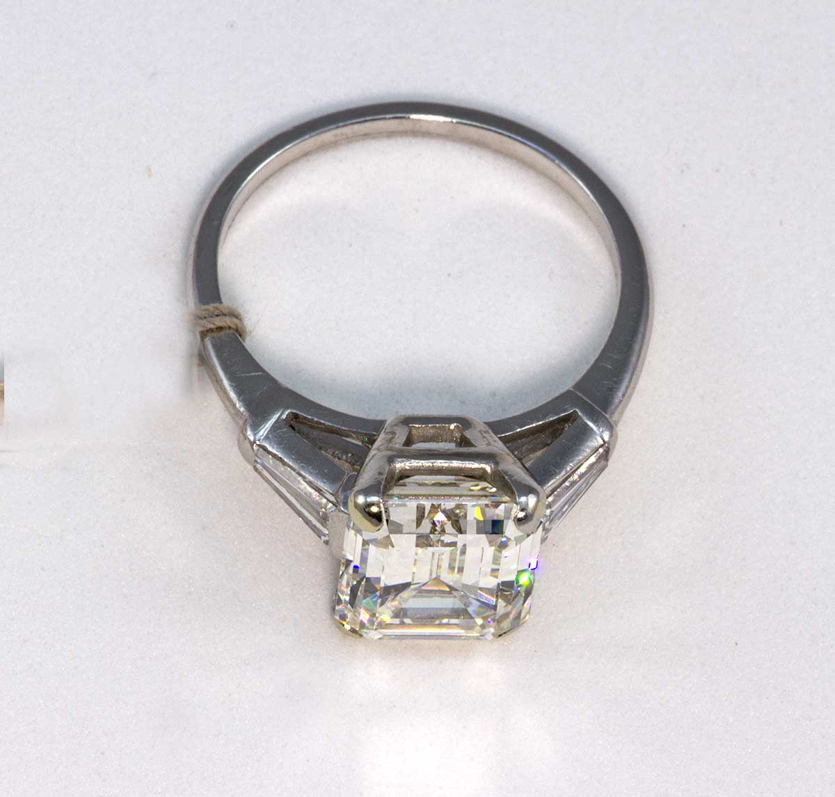 Platinum emerald cut diamond ring 4.75 ct. center K-VS1 with two baguettes .30cts.