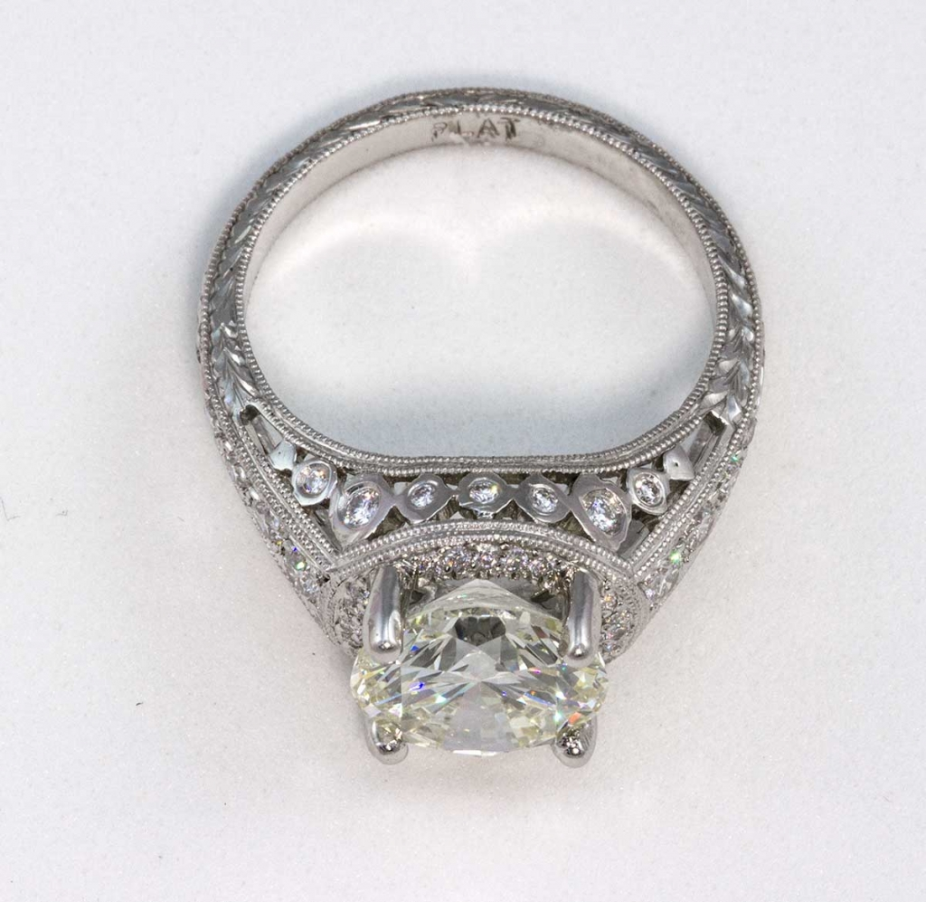 Platinum ring with center stone weighing 3.05ct VVS2 and L color, total weight of remaining stones .44ct