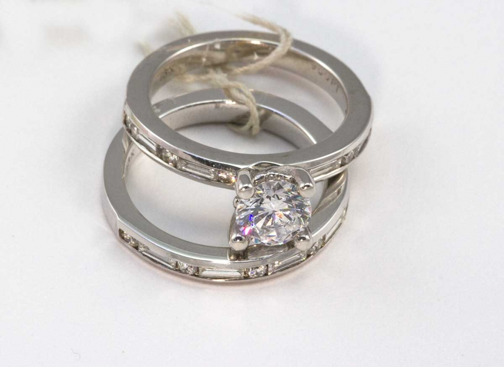 18Kt white gold .59 total weight SI1 mounting , wedding band total weight .70. wedding set