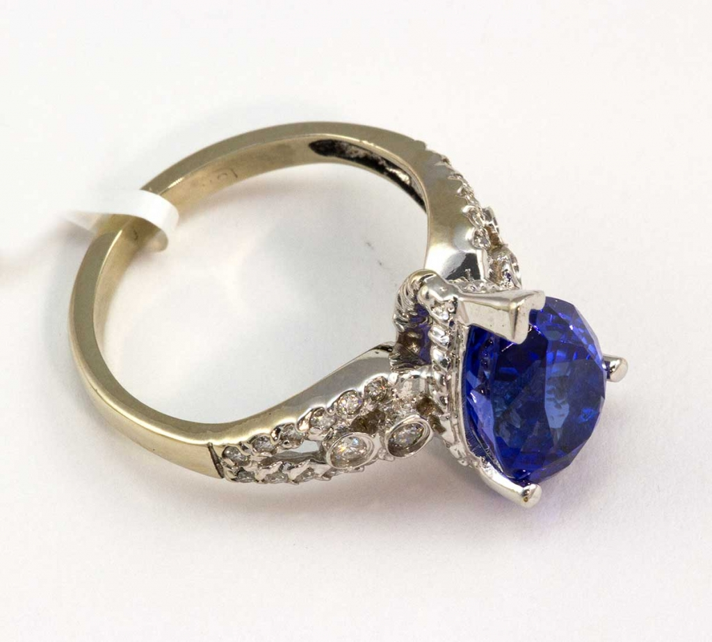 18 kt white gold pear tanzanite total weight of center stone 4.63, total diamond weight .35ct.